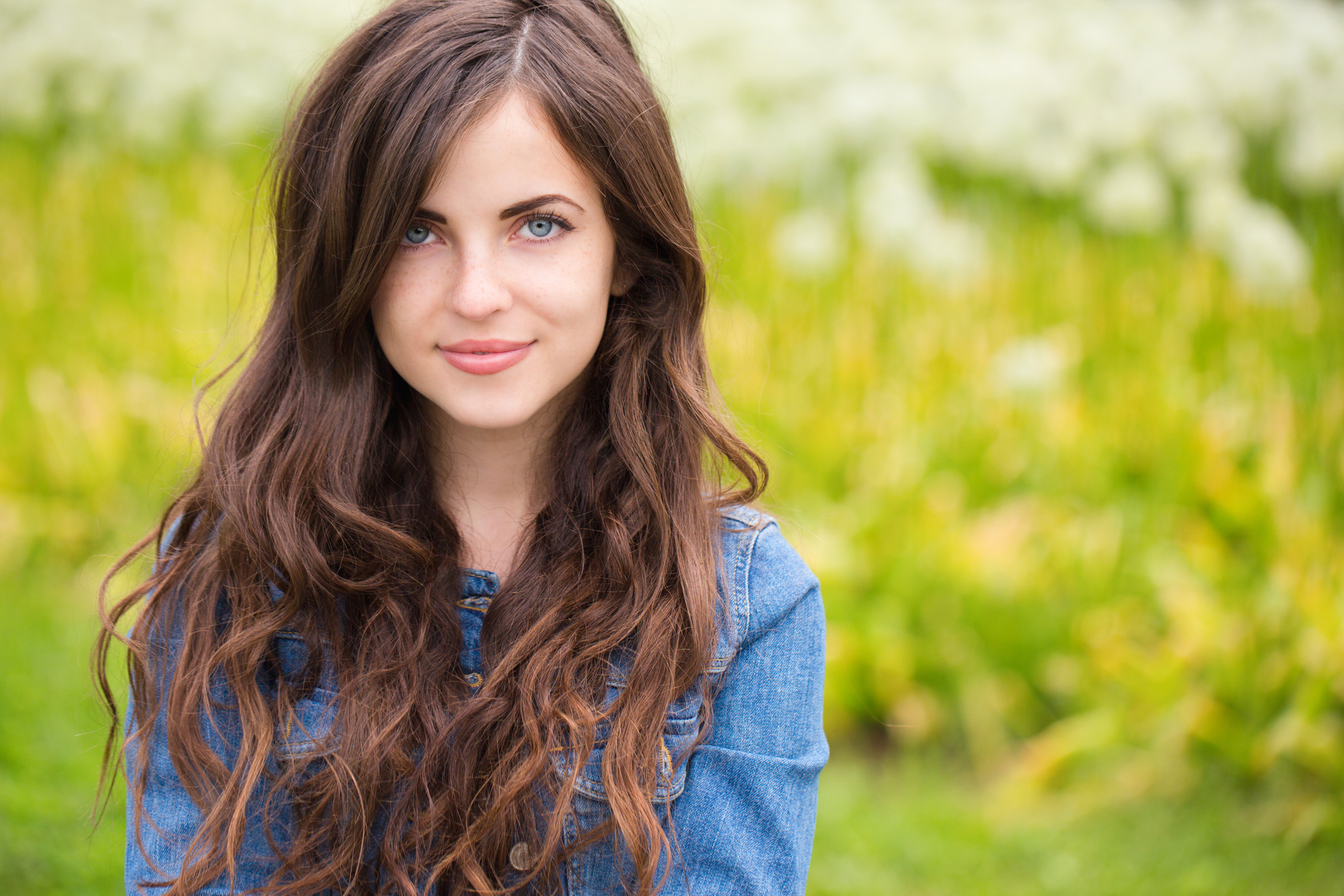 Portrait of a beautiful young woman outdoor accolades for Accolades salon reviews