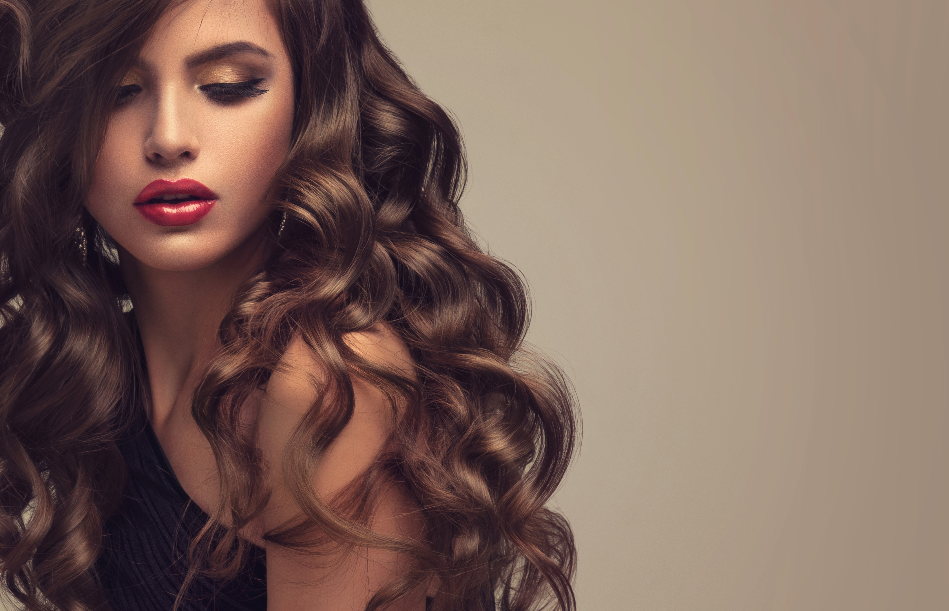 Young Attractive Brunette With Voluminous Shiny And Curly